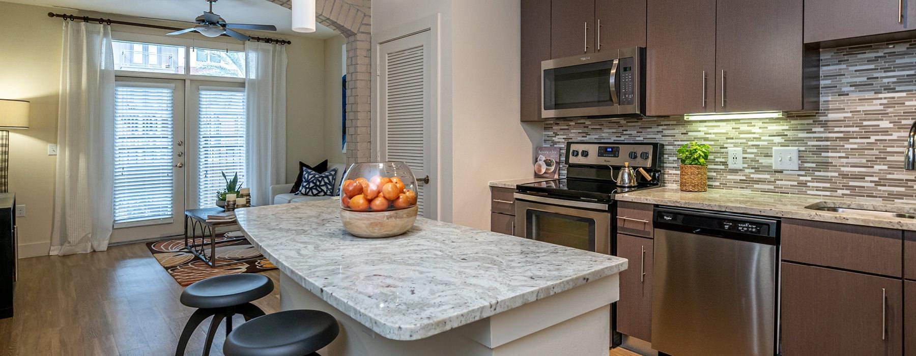 open concept kitchen adjacent to living room