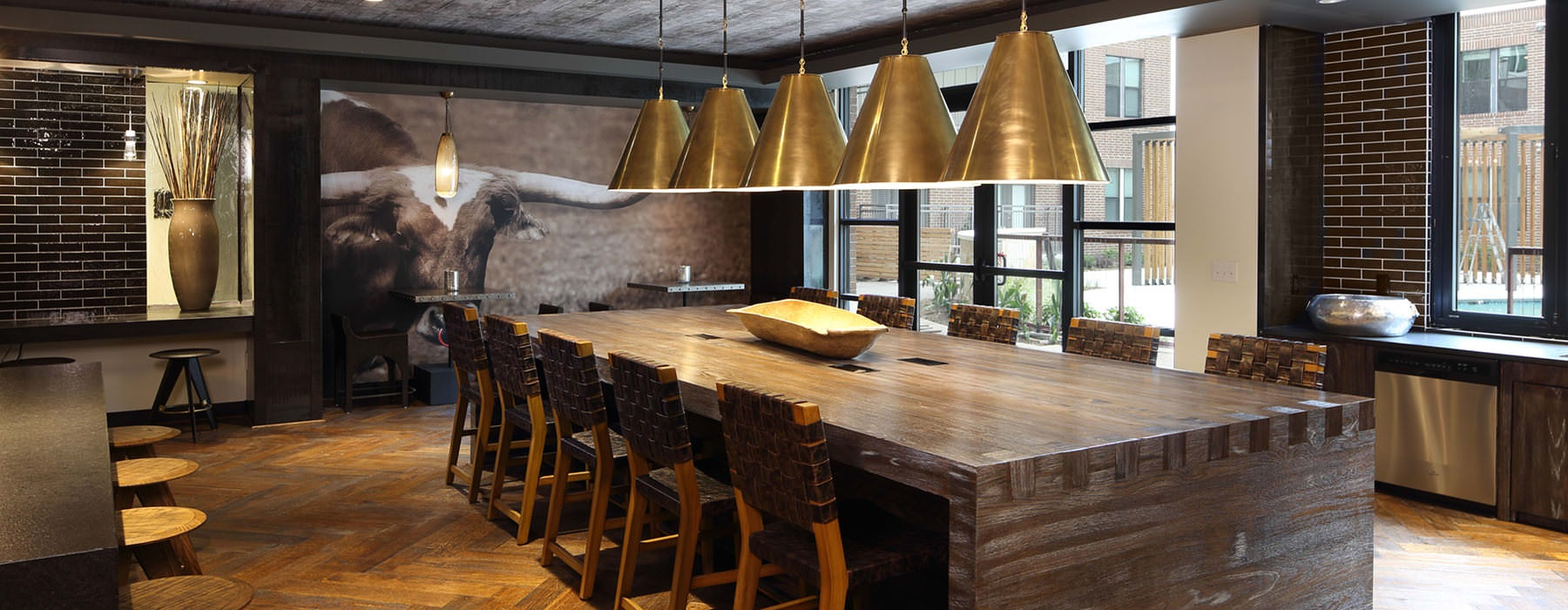 large windows and indoor lighting brighten dining area in clubhouse